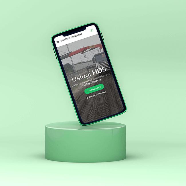 Telefon z widocznym projektem strony internetowej dla Jaskółka HDS